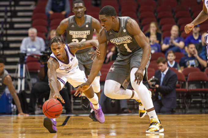 Kansas State guard DaJuan Gordon (3) and Mississippi State forward Reggie Perry (1) chase a loose ball during the first half of the Never Forget Tribute Classic NCAA college basketball game, Saturday, Dec. 14, 2019, in Newark, N.J. (AP Photo/Corey Sipkin)
