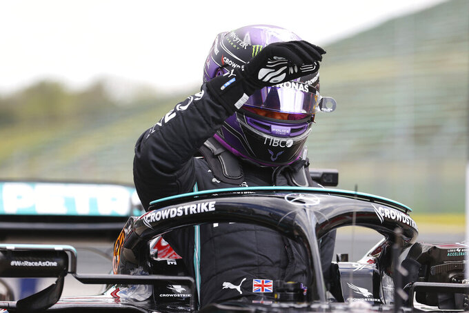 Mercedes driver Lewis Hamilton of Britain get out of his car after taking the fastest time during qualifying practice for Sunday's Emilia Romagna Formula One Grand Prix, at the Imola track, Italy, Saturday, April 17, 2021. (Bryn Lennon/Pool photo via AP)