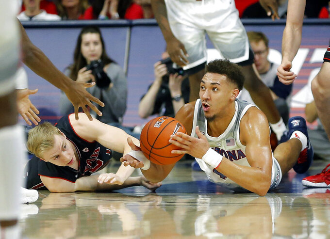 Arizona center Chase Jeter, right, and Utah guard Parker Van Dyke battle for a loose ball in the first half during an NCAA college basketball game, Saturday, Jan. 5, 2019, in Tucson, Ariz. (AP Photo/Rick Scuteri)
