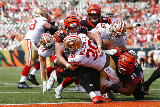 San Francisco 49ers running back Jeffrey Wilson (30) scores a touchdown against Cincinnati Bengals outside linebacker Nick Vigil (59) during the second half an NFL football game, Sunday, Sept. 15, 2019, in Cincinnati. (AP Photo/Frank Victores)