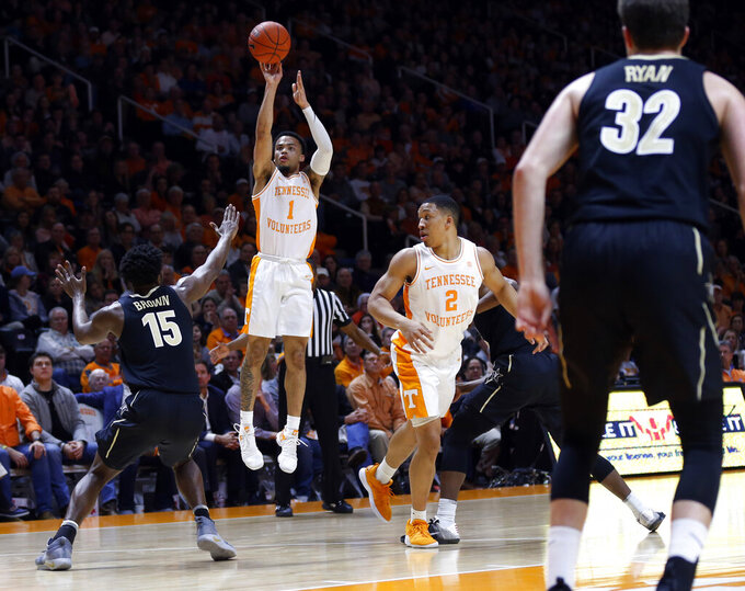 Tennessee guard Lamonte Turner (1) shoots over Vanderbilt forward Clevon Brown (15) during the first half of an NCAA college basketball game Tuesday, Feb. 19, 2019, in Knoxville, Tenn. (AP Photo/Wade Payne)