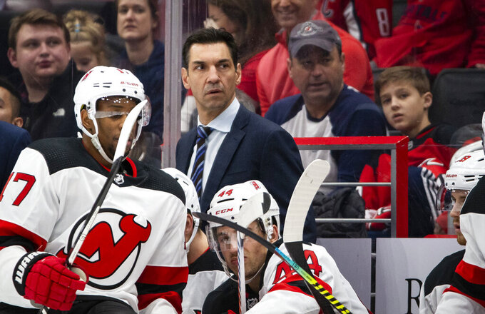 FILE - In this Jan. 16, 2020, file photo, New Jersey Devils interim coach Alain Nasreddine watches during the second period of the team's NHL hockey game against the Washington Capitals in Washington. Nasreddine is focusing on a having his team ready to play should the NHL resume games after a pause caused by coronavirus pandemic rather than whether he will have a job next year. (AP Photo/Al Drago, File)