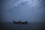 In this July 15, 2019 photo, Ethiopian migrants board a boat on the uninhabited coast outside the town of Obock, Djibouti, the shore closest to Yemen. Tens of thousands of East African migrants depart for Yemen each year hoping to pass through to Saudi Arabia, where good jobs await. But many who land in the Yemeni town of Ras Al-Ara encounter extortion, rape and torture. (AP Photo/Nariman El-Mofty)