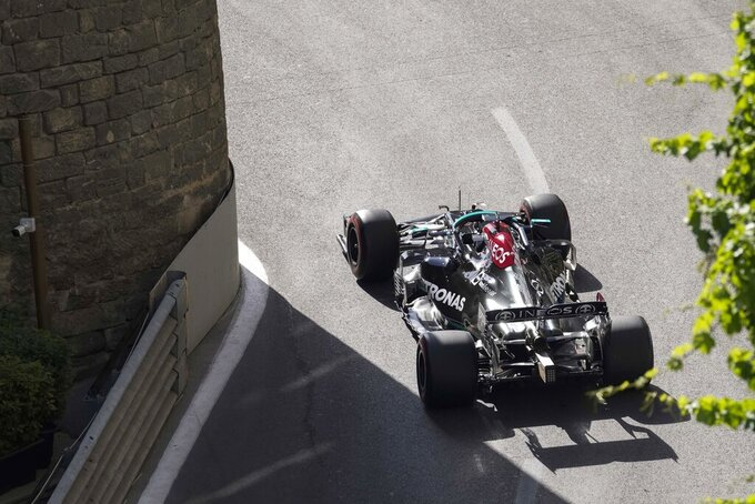 Mercedes driver Lewis Hamilton of Britain steers his car during the second free practice at the Baku Formula One city circuit, in Baku, Azerbaijan, Friday, June 4, 2021. The Formula one race will be held on Sunday. (AP Photo/Darko Vojinovic)