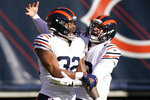 Chicago Bears running back David Montgomery (32) celebrates a touchdown run with quarterback Mitchell Trubisky (10) during the first half of an NFL football game against the Houston Texans, Sunday, Dec. 13, 2020, in Chicago. (AP Photo/Nam Y. Huh)