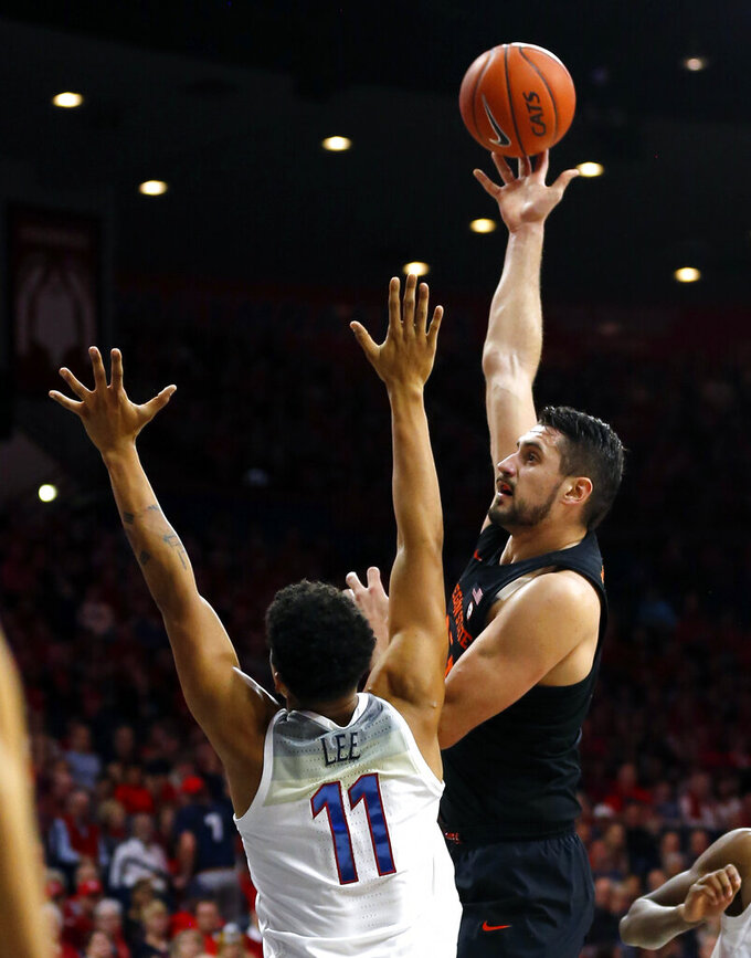 Oregon State center Gligorije Rakocevic, right, shoots over Arizona forward Ira Lee (11) in the first half during an NCAA college basketball game, Saturday, Jan. 19, 2019, in Tucson, Ariz. (AP Photo/Rick Scuteri)