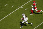 Las Vegas Raiders wide receiver Henry Ruggs III (11) runs from Kansas City Chiefs cornerback Charvarius Ward (35) during a 72-yard touchdown reception in the first half of an NFL football game, Sunday, Oct. 11, 2020, in Kansas City. (AP Photo/Charlie Riedel)