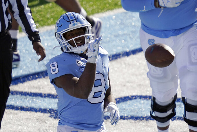 North Carolina running back Michael Carter (8) reacts following a touchdown against Western Carolina during the first half of an NCAA college football game in Chapel Hill, N.C., Saturday, Dec. 5, 2020. (AP Photo/Gerry Broome)