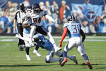 Chicago Bears wide receiver Cordarrelle Patterson (84) leaps over Tennessee Titans inside linebacker Jayon Brown (55) in the first half of an NFL football game Sunday, Nov. 8, 2020, in Nashville, Tenn. (AP Photo/Ben Margot)