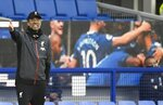 Liverpool's manager Jurgen Klopp shouts during the English Premier League soccer match between Everton and Liverpool at Goodison Park in Liverpool, England, Sunday, June 21, 2020. (Peter Powell/Pool via AP)