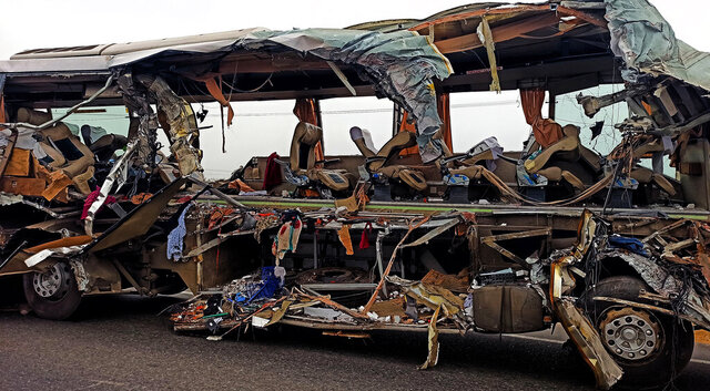 The remains of a Kerala state-run bus that collided head-on with a truck near Avanashi, Tamil Nadu state, India, Thursday, Feb.20, 2020. At least 19 people were killed and more than 20 were injured in the accident. (AP Photo)
