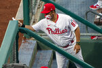 Philadelphia Phillies Infield Coordinator Juan Castro wipes down the railing during the first inning of a baseball game against the Miami Marlins, Friday, July 24, 2020, in Philadelphia. (AP Photo/Chris Szagola)
