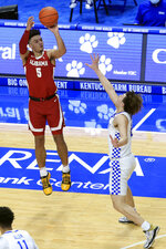 Alabama's Jaden Shackelford (5) shoots a 3-pointer over Kentucky's Devin Askew during the first half of an NCAA college basketball game in Lexington, Ky., Tuesday, Jan. 12, 2021. (AP Photo/James Crisp)