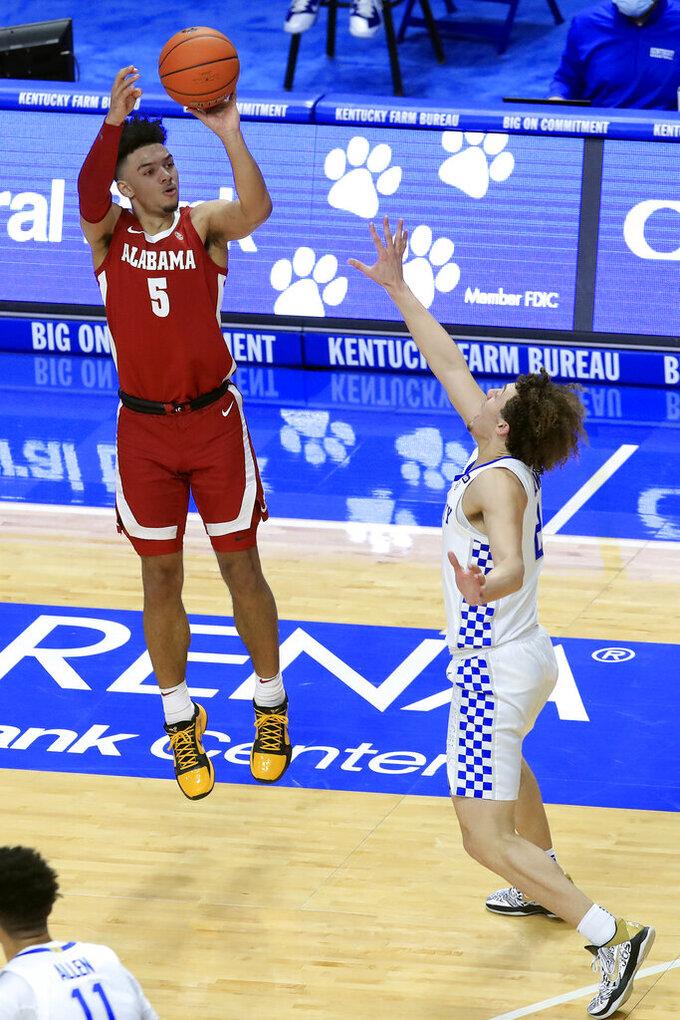 Alabama's Jaden Shackelford (5) shoots a 3-pointer over Kentucky's Devin Askew during the first half of an NCAA college basketball game in Lexington, Ky., Tuesday, Jan. 12, 2021. (AP Photo/James Crisp)