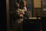 This image released by Universal Pictures shows Ryan Gosling as Neil Armstrong and Connor Blodgett as Mark Armstrong in a scene from