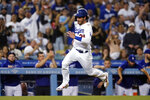 Los Angeles Dodgers' Cody Bellinger heads for home, scoring on a single by AJ Pollock during the third inning of the team's baseball game against the Pittsburgh Pirates on Tuesday, Aug. 17, 2021, in Los Angeles. (AP Photo/Marcio Jose Sanchez)