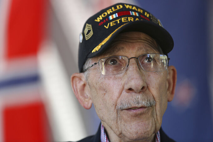 FILE - World War II veteran Louis Graziano reflects on his service while visiting the National D-Day Memorial in Bedford with his family on Tuesday, Sept. 24, 2019. The 98-year-old World War II veteran who took part in the D-Day invasion and the Battle of the Bulge and witnessed the German surrender during the war has been honored by France for his military contributions. The Atlanta Journal-Constitution reports that Graziano was given the French Legion of Honor during a ceremony on Friday, Sept. 17 in Thomson, Ga., where he lives. (Heather Rousseau/The Roanoke Times via AP, File)
