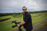 Korey Rowe uses his video camera near his home in Oneonta, N.Y. on Thursday, Aug. 12, 2021. Korey Rowe served tours in Iraq and Afghanistan and returned to the U.S. in 2004 traumatized and disillusioned. His experiences overseas and nagging questions about Sept. 11, 2001 convinced him America's leaders were lying about what happened that day and the wars that followed. (AP Photo/Robert Bumsted)