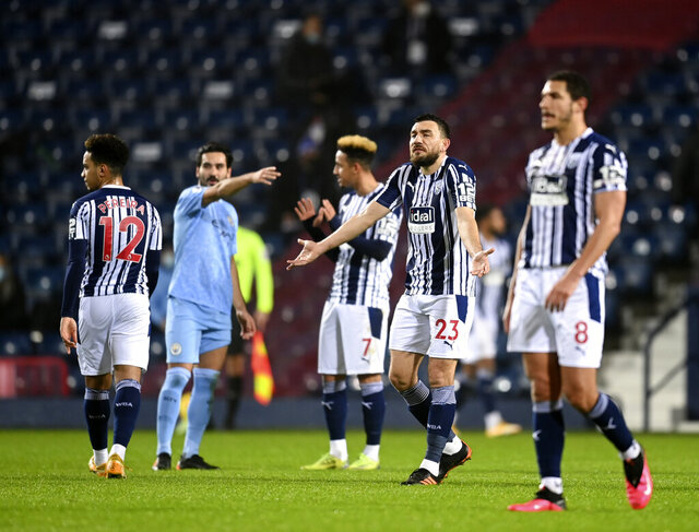 West Bromwich Albion players react after Manchester City's Joao Cancelo scoring his side's second goal during the English Premier League soccer match between West Bromwich Albion and Manchester City at the Hawthorns stadium in West Bromwich, England, Tuesday, Jan. 26, 2021. (Michael Regan/Pool via AP)