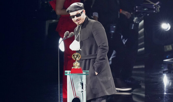 """J Balvin accepts the award for best urban music album for """"Colores"""" at the 21st Latin Grammy Awards, airing on Thursday, Nov. 19, 2020, at American Airlines Arena in Miami. (AP Photo/Marta Lavandier)"""