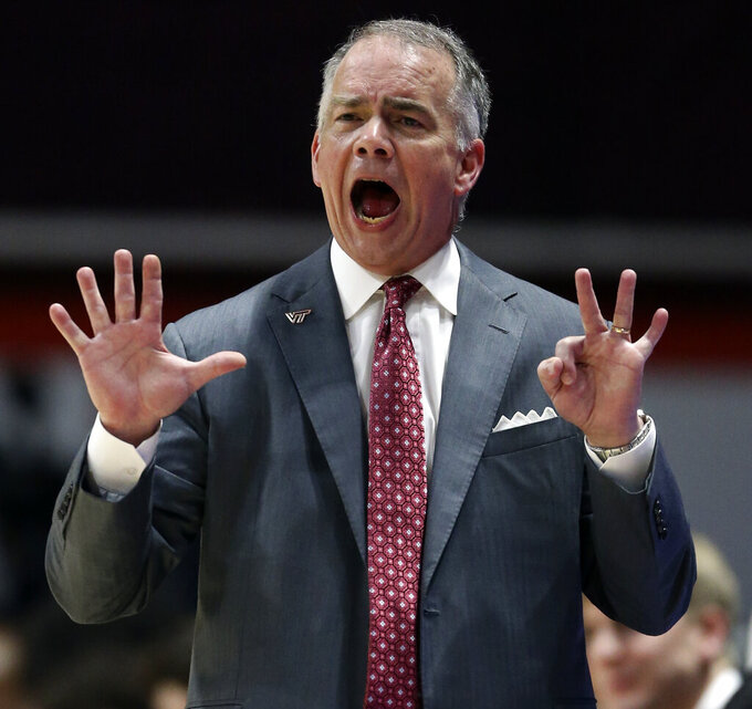 Virginia Tech coach Mike Young gestures during the first half of the team's NCAA college basketball game against Virginia on Wednesday, Feb. 26, 2020, in Blacksburg, Va. (Matt Gentry/The Roanoke Times via AP)