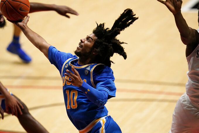 UCLA guard Tyger Campbell shoots during the first half of the team's NCAA college basketball game against San Diego State, Wednesday, Nov. 25, 2020, in San Diego. (AP Photo/Gregory Bull)