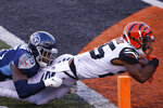 Cincinnati Bengals' Giovani Bernard (25) dives in for a touchdown while being tackled by dTennessee Titans' Jayon Brown (55) during the second half of an NFL football game, Sunday, Nov. 1, 2020, in Cincinnati. (AP Photo/Gary Landers)