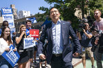 New York City mayoral candidate Andrew Yang arrives to an early voting site before casting his vote, Wednesday, June 16, 2021, in New York. Candidates in New York City's heavily contested Democratic mayoral primary urged people to go to the polls in the coming days as early voting kicked off Wednesday. (AP Photo/John Minchillo)