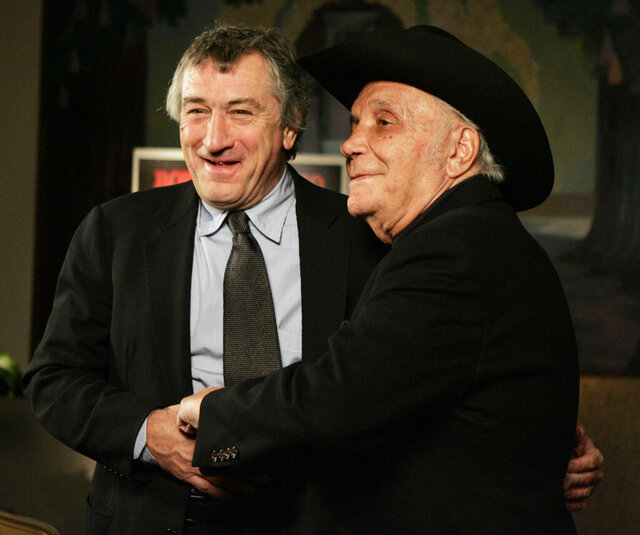 FILE - In this Jan. 27, 2005, file photo, Robert De Niro, left, and boxer Jake LaMotta stand for photographers before watching a 25th anniversary screening of the movie
