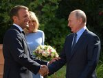 French President Emmanuel Macron, left, his wife Brigitte, welcome Russian President Vladimir Putin at the fort of Bregancon in Bormes-les-Mimosas, southern France, Monday Aug. 19, 2019. French President Emmanuel Macron and Russian President Vladimir Putin are meeting to discuss the world's major crises, including Ukraine, Iran and Syria, and try to improve Moscow's relations with the European Union. (Alexei Druzhinin, Sputnik, Kremlin Pool Photo via AP)