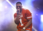 """FILE - This Oct. 6, 2018 file photo shows Nelly performing at the Austin City Limits Music Festival in Austin, Texas.  Nelly will perform in Maryland Heights, Mo., near St. Louis, as part of Live Nation's """"Live from the Drive-In concert series taking place July 10-12. (Photo by Jack Plunkett/Invision/AP, File)"""