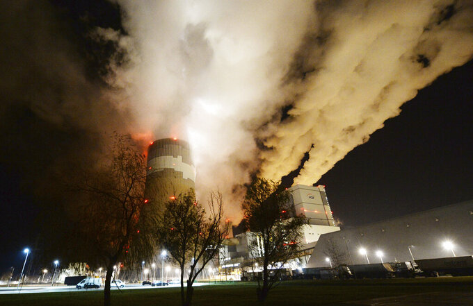 FILE - In this Wednesday, Nov. 28, 2018 file photo, clouds of smoke are pictured over Europe's largest lignite power plant in Belchatow, central Poland. Polish energy officials said Tuesday June 22, 2021, that human error was to blame for a massive outage at Europe's largest brown coal power plant of Belchatow last month and a separate fire there just days later, according to the state PAP news agency. (AP Photo/Czarek Sokolowski, file)