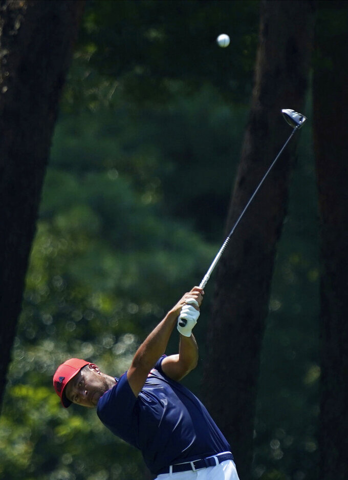 CORRECTS LAST NAME TO SCHAUFFELE FROM SHAUFFELE -  Xander Schauffele of the United States watches his tee shot on the 6th hole during the final round of the men's golf event at the 2020 Summer Olympics on Sunday, Aug. 1, 2021, in Kawagoe, Japan. (AP Photo/Matt York)