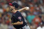 Washington Nationals starting pitcher Max Scherzer the throws during the first inning of Game 1 of the baseball World Series against the Houston Astros Tuesday, Oct. 22, 2019, in Houston. (AP Photo/David J. Phillip)