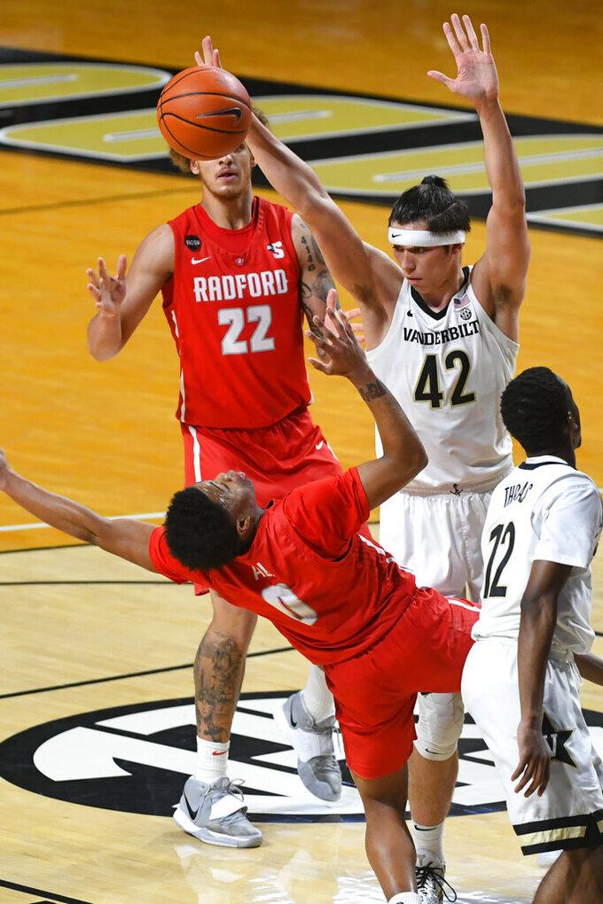 Vanderbilt forward Quentin Millora-Brown (42) blocks a shot attempt by Radford guard Fah'Mir Ali (0) during the second half of an NCAA college basketball game Saturday, Dec. 19, 2020, in Nashville, Tenn. Vanderbilt won 59-50. (AP Photo/John Amis)