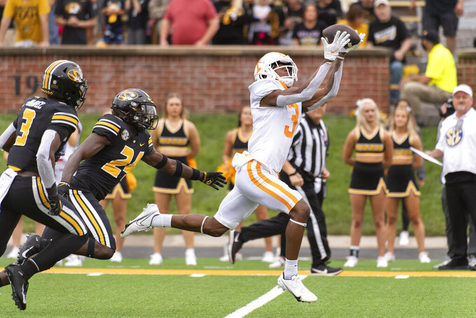 Tennessee wide receiver JaVonta Payton, right, catches a touchdown pass in front of Missouri defensive back Martez Manuel, left, and Allie Green IV, center, during the first half of an NCAA college football game Saturday, Oct. 2, 2021, in Columbia, Mo. (AP Photo/L.G. Patterson)