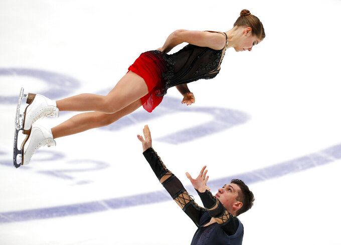Russia's Anastasia Mishina and Aleksandr Galliamov perform in the pairs short program during the ISU Grand Prix of Figure Skating Rostelecom Cup in Moscow, Russia,Friday, Nov. 20, 2020. (AP Photo/Alexander Zemlianichenko)