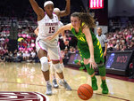 Oregon guard Sabrina Ionescu (20) moves the ball past Stanford forward Maya Dodson (15) during the second half of an NCAA college basketball game Sunday, Feb. 10, 2019, in Stanford, Calif. Oregon won 88-48. (AP Photo/Tony Avelar)
