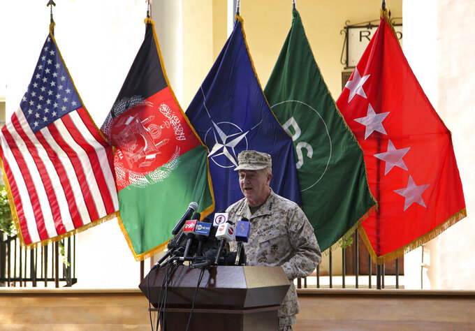 """Marine Gen. Frank McKenzie, the head of U.S. Central Command, speaks at a handover of comand ceremony, at Resolute Support headquarters, in Kabul, Afghanistan, Monday, July 12, 2021. The United States is a step closer to ending a 20-year military presence that became known as its """"forever war,"""" as Taliban insurgents continue to gain territory across the country. (AP Photo/Ahmad Seir)"""