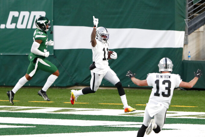 Las Vegas Raiders' Henry Ruggs III, center, celebrates his touchdown during the second half an NFL football game against the New York Jets, Sunday, Dec. 6, 2020, in East Rutherford, N.J. (AP Photo/Noah K. Murray)