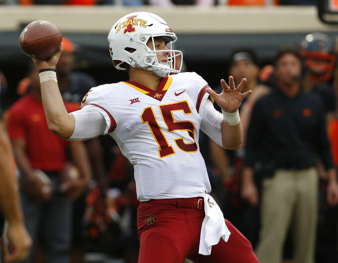 FILE - In this Saturday, Oct. 6, 2018, file photo, Iowa State quarterback Brock Purdy (15) throws in the second half of an NCAA college football game against Oklahoma State in Stillwater, Okla. Iowa State is on its third starting quarterback with true freshman Brock Purdy, who last week at then-No. 25 Oklahoma State entered on the second series. He threw for 318 yards with four touchdowns, and ran for 84 yards and another score in a 48-42 victory. (AP Photo/Sue Ogrocki, File)