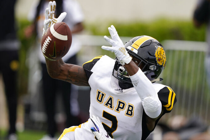 Arkansas-Pine Bluff wide receiver Josh Wilkes (3) reaches for a pass against Alabama A&M during the second half of the Southwestern Athletic Conference Championship NCAA college football game, Saturday, May 1, 2021, in Jackson, Miss. Alabama A&M won 40-33. (AP Photo/Rogelio V. Solis)