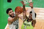 Boston Celtics forward Jayson Tatum (0) goes to the basket against Minnesota Timberwolves forward Jaden McDaniels (3) during the second quarter of an NBA basketball game Friday, April 9, 2021, in Boston. (AP Photo/Elise Amendola)
