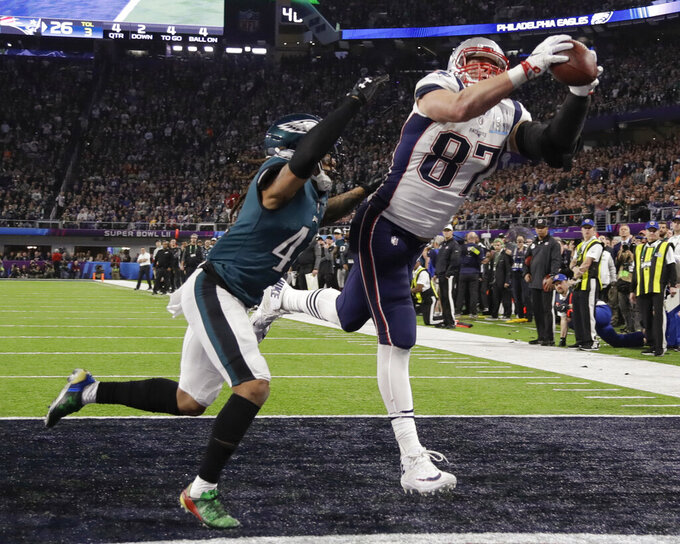 "FILE - In this Feb. 4, 2018, file photo, New England Patriots' Rob Gronkowski (87) makes a touchdown reception against Philadelphia Eagles cornerback Ronald Darby during the second half of the NFL Super Bowl 52 football game in Minneapolis. Gronkowski says he is retiring from the NFL after nine seasons. Gronkowski announced his decision via a post on Instagram Sunday, March 24, 2019, saying that a few months shy of this 30th birthday ""its time to move forward and move forward with a big smile."" (AP Photo/Chris O'Meara. File)"