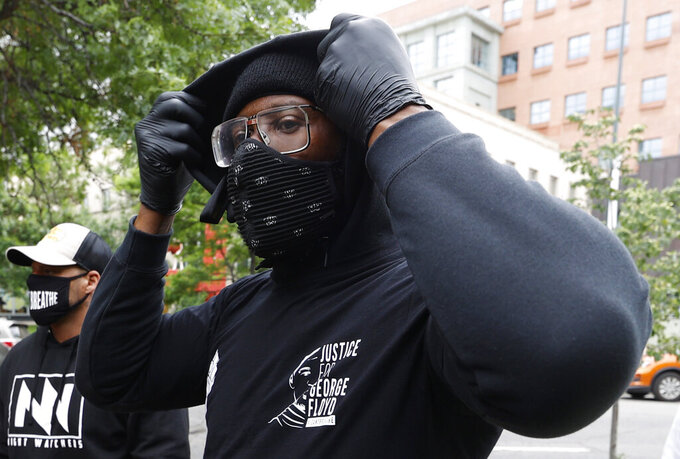 Denver Broncos linebacker Von Miller pulls up the hood on his sweater to take part in a rally with teammates in the Greek Amphitheatre in Civic Center Park over the death of George Floyd Saturday, June 6, 2020, in downtown Denver. (AP Photo/David Zalubowski)