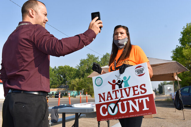 FILE - In this Aug. 26, 2020 file photo, activist Lauri Dawn Kindness, right, speaks at the Crow Indian Reservation, in Lodge Grass, Mont. Native Americans make up less than 2% of the U.S. population and often are listed in datasets as