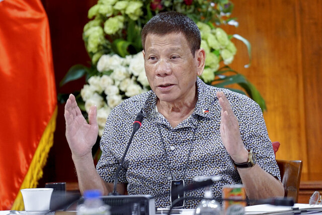 In this handout photo provided by the Malacanang Presidential Photographers Division, Philippine President Rodrigo Duterte gestures as he meets members of the Inter-Agency Task Force on the Emerging Infectious Diseases at the Malacanang presidential palace in Manila, Philippines on Monday Aug. 30, 2020. Duterte publicly ordered the country's top customs official to shoot and kill drug smugglers in one of his most overt threats during a deadly four-year campaign that has been the centerpiece of his presidency. (King Rodriguez/Malacanang Presidential Photographers Division via AP)