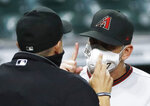 Arizona Diamondbacks manager Torey Lovullo argues with umpire Adam Hamari after being ejected for arguing balls and strikes in the top of the fourth inning against the Houston Astros on Sunday, Sept. 20, 2020 at Minute Maid Park. (Kevin M. Cox/The Galveston County Daily News via AP)