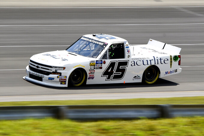 Ross Chastain drives into Turn 1 during a NASCAR Truck Series auto race, Saturday, July 27, 2019, in Long Pond, Pa. Chastain won the race. (AP Photo/Derik Hamilton)