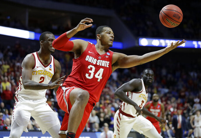 FILE - In this March 22, 2019, file photo, Ohio State's Kaleb Wesson (34) reaches for a rebound between Iowa State's Cameron Lard (2) and Marial Shayok (3) during the second half of a first round game in the NCAA college basketball tournament in Tulsa, Okla.  Wesson's decision to return could make Ohio State a top-10 team next season.  (AP Photo/Jeff Roberson, File)
